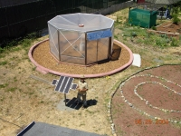 Greenhouse from top with the solar panel for a water-pump